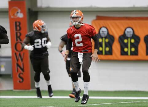 Cleveland Browns quarterback Johnny Manziel (2) warms up for a rookie minicamp practice at the NFL football team's facility in Berea, Ohio Saturday, May 17, 2014. (AP Photo/Mark Duncan) Photo: Mark Duncan, Associated Press