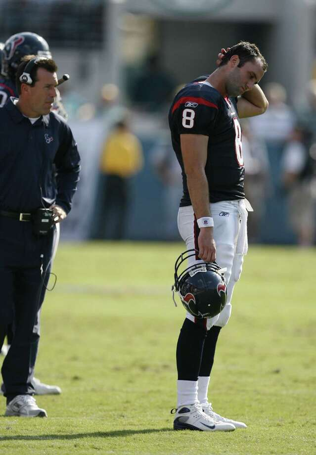 Texans quarterback Matt Schaub (right) stands on the sidelines after throwing an interception to the Jacksonville Jaguars during the fourth quarter as the Texans head coach Gary Kubiak (left) looks on at Jacksonville Municipal Stadium Sunday, Oct. 14, 2007, in Jacksonville. The Jaguars defeated the Texans 37-17. Photo: James Nielsen, Houston Chronicle / Houston Chronicle