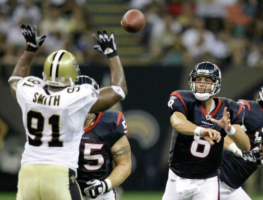 Texans quarterback Matt Schaub (8) throws a pass over the outstretched arms of New Orleans Saints defensive end Will Smith (91) during the second quarter of an NFL pre-season football game in the Superdome Saturday, Aug. 16, 2008, in New Orleans. Photo: Brett Coomer, Houston Chronicle / Houston Chronicle
