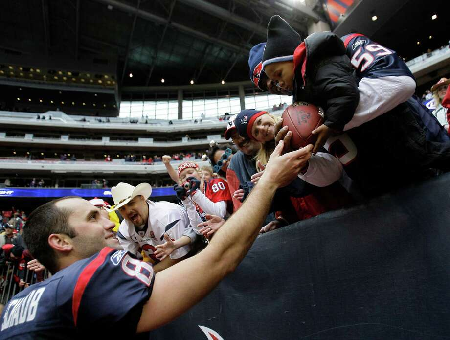 Texans quarterback Matt Schaub (8) hands a game ball to a fan following the Texans victory over the Chicago Bears in the final game of the season at Reliant Stadium Sunday, Dec. 28, 2008, in Houston.  The Texans defeated the Bears by a score of  31-24 to finish the season 8-8. Photo: Brett Coomer, Houston Chronicle / Houston Chronicle
