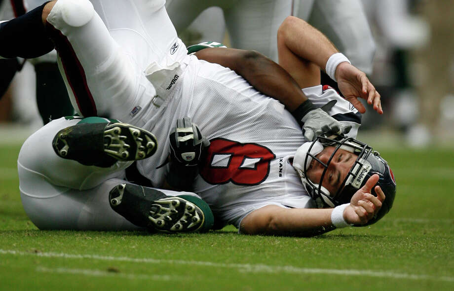 Texans quarterback Matt Schaub (8) is thrown down to the turf after delivering a pass  during the 1st quarter of the Houston Texans-New York Jets NFL football game at Reliant Stadium,  Sunday, Sept. 13, 2009, in Houston. Photo: Karen Warren, Houston Chronicle / Houston Chronicle