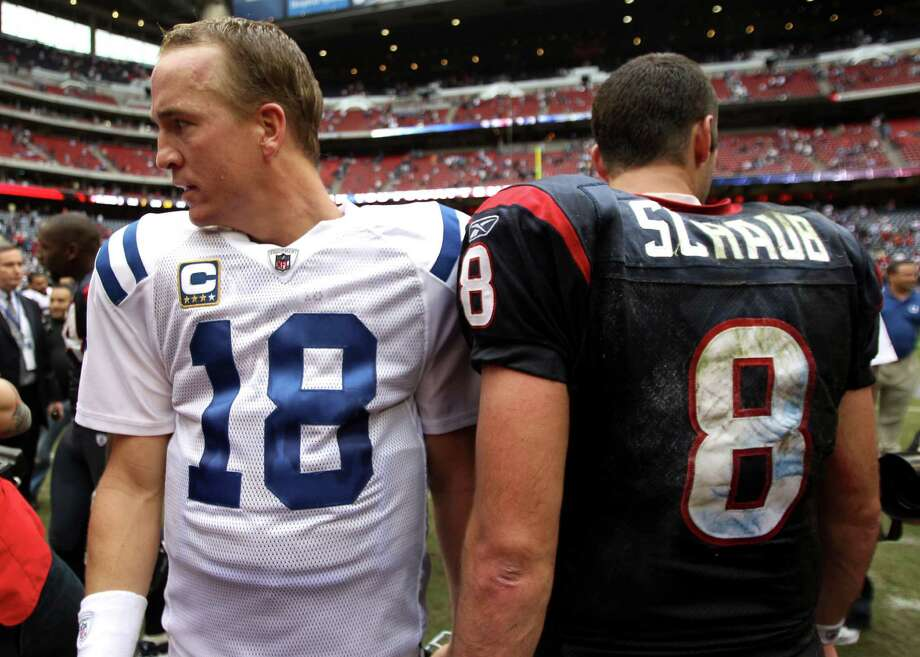 Colts quarterback Peyton Manning (18) and Houston Texans quarterback Matt Schaub (8) walk away from each other after the Colts beat the Texans in an NFL football game at Reliant Stadium Sunday, Nov. 29, 2009, in Houston. The Colts beat the Texans 35-27. Photo: Brett Coomer, Houston Chronicle / Houston Chronicle