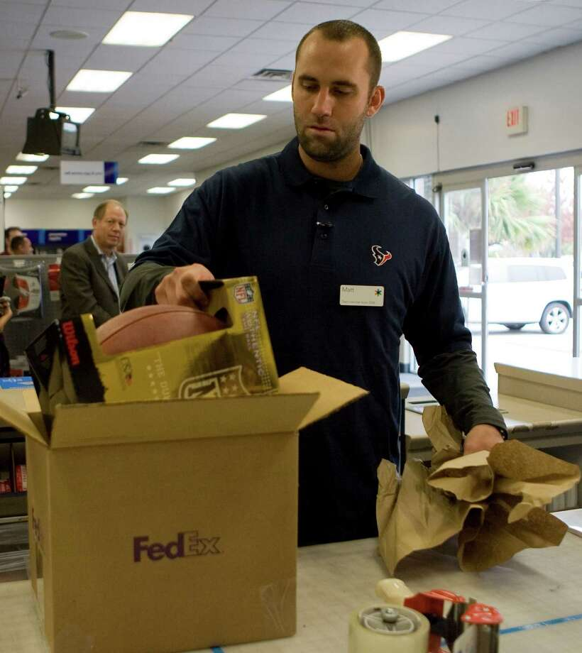 "Texans quarterback Matt Schaub boxes up a football during the FedEx Office ""Pack and Ship"" promotion at the FedEx Office location at 2200 Southwest Freeway Tuesday, Dec. 1, 2009, in Houston. Photo: James Nielsen, Houston Chronicle / Houston Chronicle"