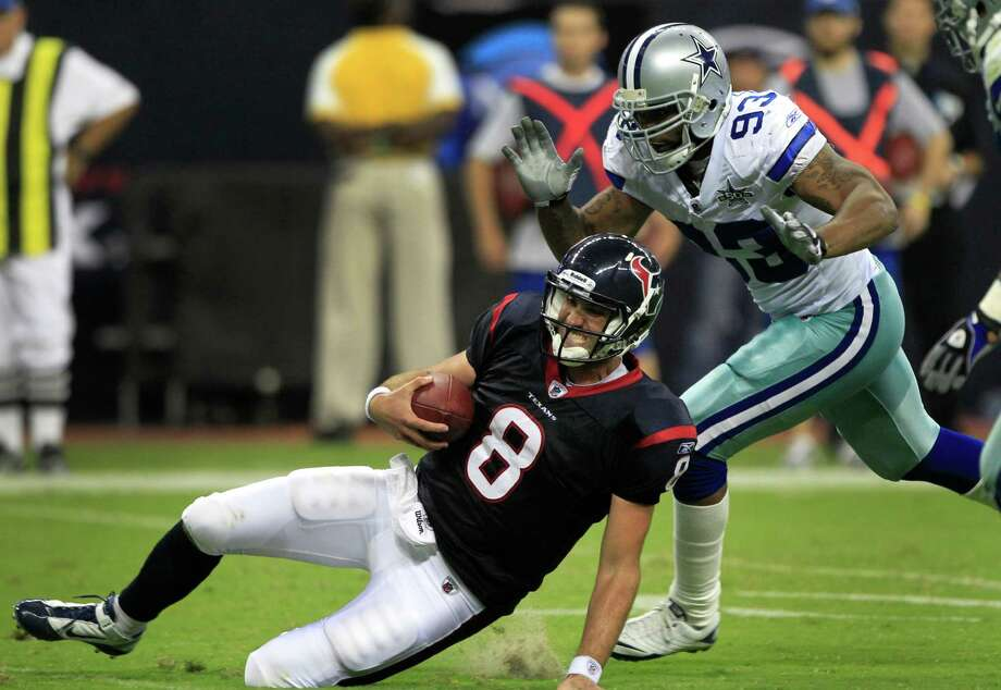 Texans quarterback Matt Schaub (8) slides as he scrambles out of the pocket away from Dallas Cowboys linebacker Anthony Spencer (93) for a four-yard gain during the third quarter of an NFL pre-season football game at Reliant Stadium Saturday, Aug. 28, 2010, in Houston. The Texans beat the Cowboys 23-7. Photo: Brett Coomer, Chronicle / Houston Chronicle