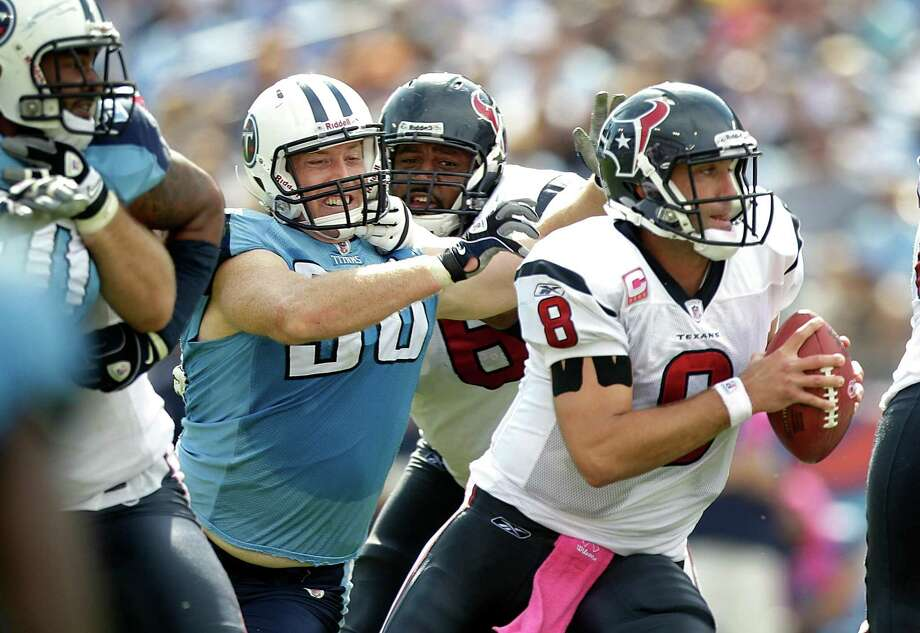 Texans quarterback Matt Schaub (8) scrambles out of the pocket pressured by Tennessee Titans defensive end Dave Ball (98) during the second quarter of an NFL football game at LP Field Sunday, Oct. 23, 2011, in Nashville. The Texans beat the Titans 41-7. Photo: Brett Coomer, Houston Chronicle / © 2011  Houston Chronicle