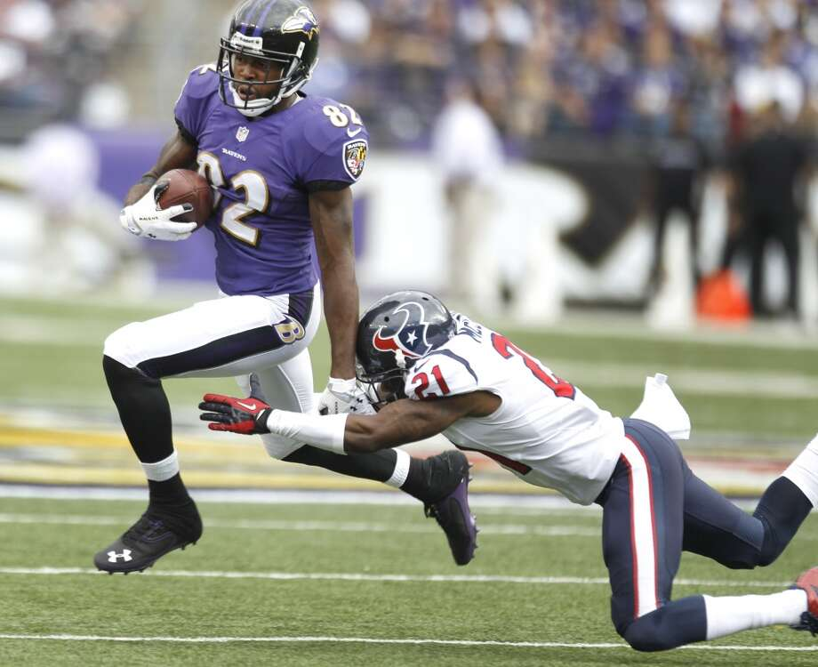 Ravens wide receiver Torrey Smith (82) breaks away from Texans cornerback Brice McCain. Photo: Brett Coomer, Houston Chronicle