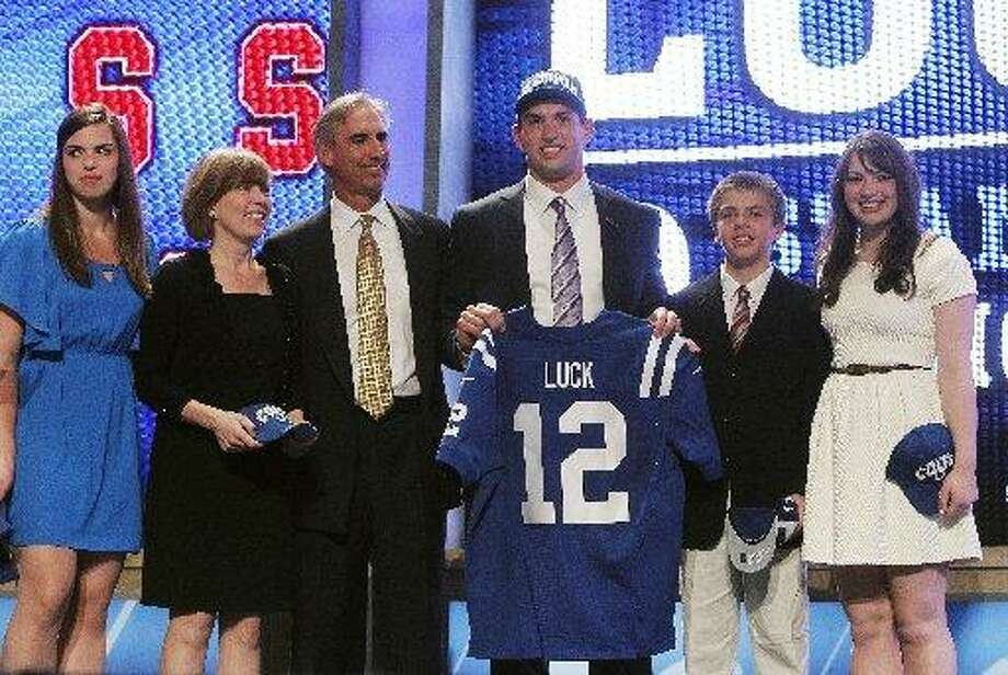 The Luck family celebrate the big day. Photo: Jason DeCrow, AP