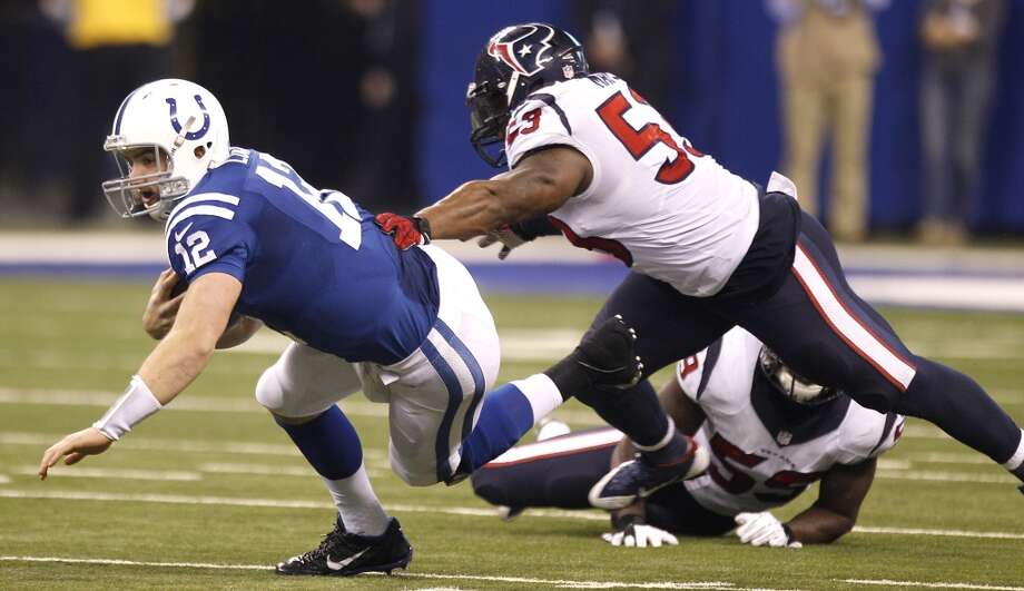 Colts quarterback Andrew Luck (12) scrambles out of the pocket, breaking away from Texans outside linebacker Whitney Mercilus (59) and inside linebacker Joe Mays (53) on Sunday, Dec. 15, 2013. Photo: Brett Coomer, Houston Chronicle