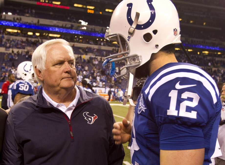 Texans interim head coach Wade Phillips, left, talks to Colts quarterback Andrew Luck (12) after the Colts 25-3 win over the Texans on Dec. 15, 2013. Photo: Brett Coomer, Houston Chronicle