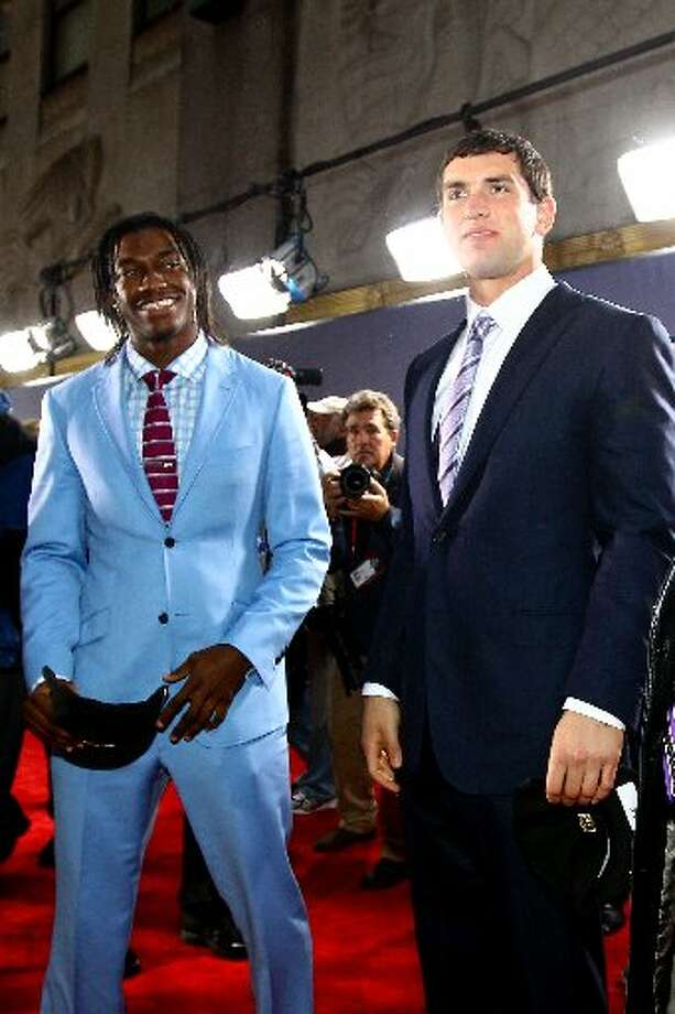 Andrew Luck is joined on the red carpet by Robert Griffin III Photo: Al Bello, Getty