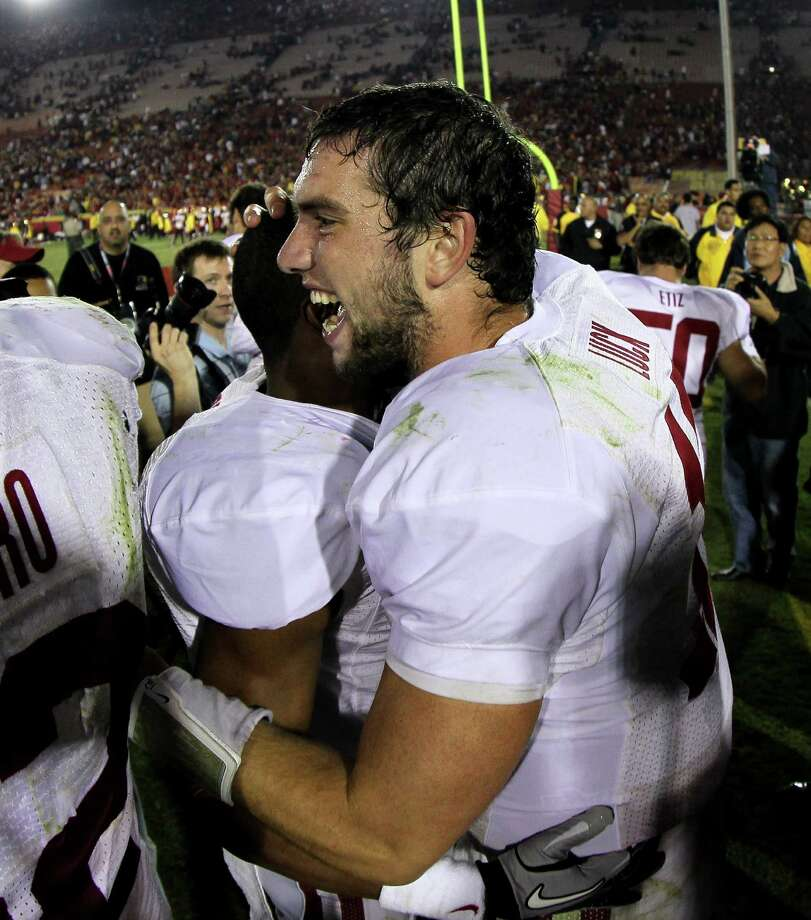 LOS ANGELES, CA - OCTOBER 29:  Quarterback Andrew Luck #12 of the Stanford Cardinal celebrates with teammates after the game with the USC Trojans at the Los Angeles Memorial Coliseum on October 29, 2011 in Los Angeles, California. Stanford won 56-48 in three overtimes.  (Photo by Stephen Dunn/Getty Images) Photo: Stephen Dunn, Getty / 2011 Getty Images