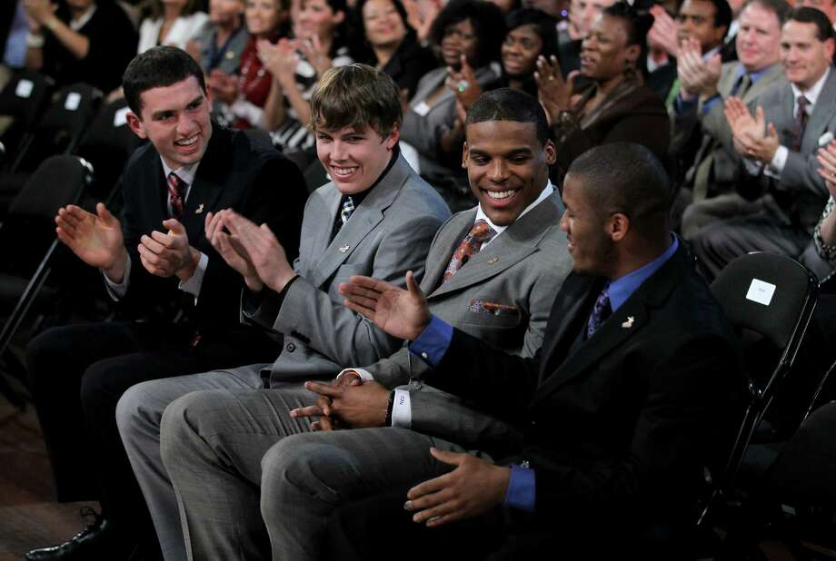 In this photo provided by the Heisman Trophy Trust, Auburn quarterback Cam Newton, second from right, is congratulated by Oregon's LaMichael James right, as Newton is announced the winner of the Heisman Trophy award, Saturday, Dec. 11, 2010, in New York, looking on are Stanford's Andrew Luck, far left, and Boise State's Kellen Moore. Newton, the third player from Auburn to win the Heisman, received 729 first-place votes and outpointed runner-up Luck by 1,184 points. (AP Photo/Heisman Trophy Trust, Kelly Kline) ** NO SALES ** Photo: Kelly Kline, ASSOCIATED PRESS / AP2010