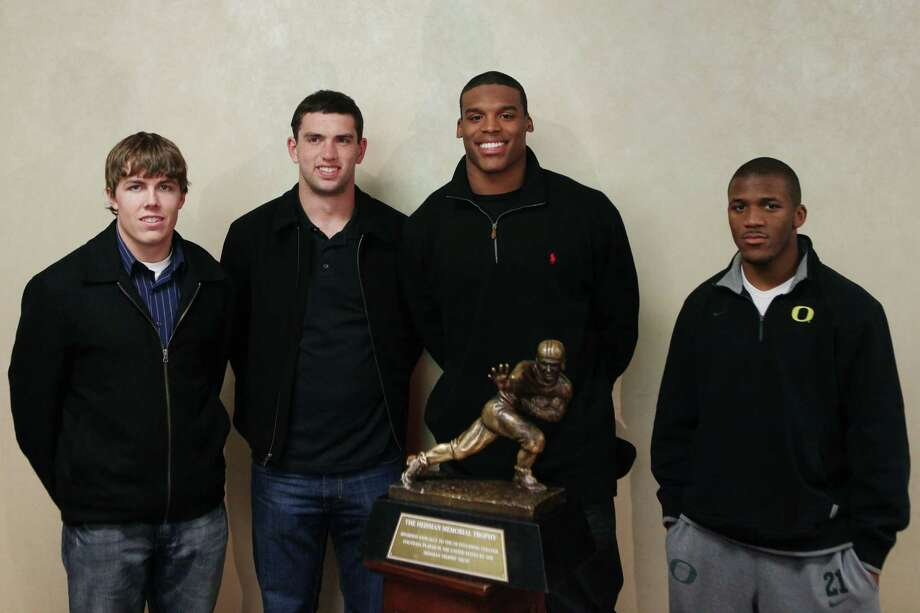 The four Heisman Trophy finalists, Boise State quarterback Kellen Moore, left, Stanford quarterback Andrew Luck, second from left, Auburn quarterback Cam Newton, second from right and Oregon running back LaMichael James, pose for a photo with the Heisman Trophy during a news conference on Friday, Dec. 10, 2010, in New York. (AP Photo/Andrew Burton) Photo: Andrew Burton, AP / FRE170478 AP