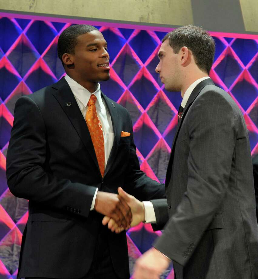 Auburn quarterback Cam Newton, left, is congratulated by Stanford quarterback Andrew Luck at the Home Depot ESPNU College Football Awards in Lake Buena Vista, Fla., Thursday, Dec. 9, 2010. Newton won the Davey O'Brien Award, for best quarterback, and the Maxwell Award, for best all-around player. Luck was a finalist for both awards. (AP Photo/Phelan M. Ebenhack) Photo: Phelan M. Ebenhack, ASSOCIATED PRESS / AP2010