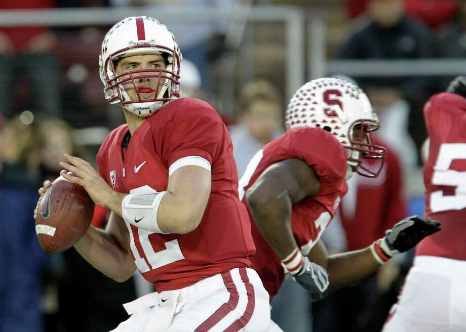 FILE - In this Nov. 27, 2010, file photo, Stanford quarterback Andrew Luck looks to pass during the first quarter of an NCAA college football game in Stanford, Calif. Luck is among the four finalists for the Heisman Trophy. (AP Photo/Paul Sakuma, File) Photo: Paul Sakuma, ASSOCIATED PRESS / AP2010