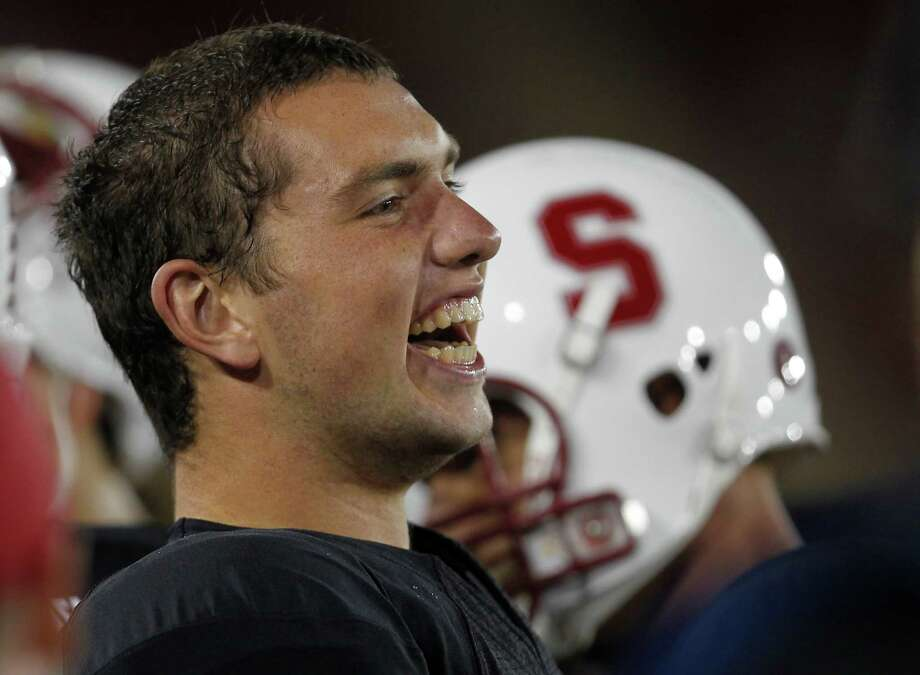 Stanford quarterback Andrew Luck (12) smiles as Stanford scored against Wake Forest in the first quarter of an NCAA college football game in Stanford, Calif., Saturday, Sept. 18, 2010. Stanford won 68-24. (AP Photo/Tony Avelar) Photo: Tony Avelar, ASSOCIATED PRESS / AP2010