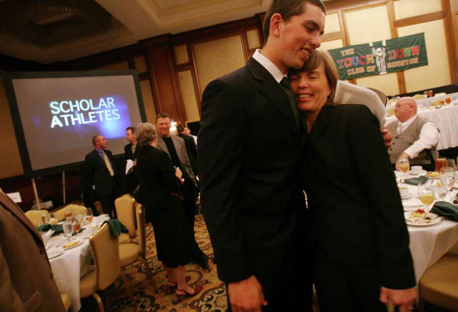 (Left to right) Andrew Luck, Stratford Quarterback, smiles as he is congratulated by his mother Kathy Luck during an interview after winning The High School Scholar-Athlete of the year at the JW Marriott where The Touchdown Club of Houston honored the top starters on area high school football teams with the highest GPAs by giving away more than $15,000 in scholarships on Wednesday, Nov. 7, 2007 in Houston, TX.    Guest speaker is Rufus Cormier, a scholar-athlete from SMU and a Houston lawyer.  Photo by Mayra Beltran / Chronicle Photo: Mayra Beltran, Houston Chronicle / Houston Chronicle