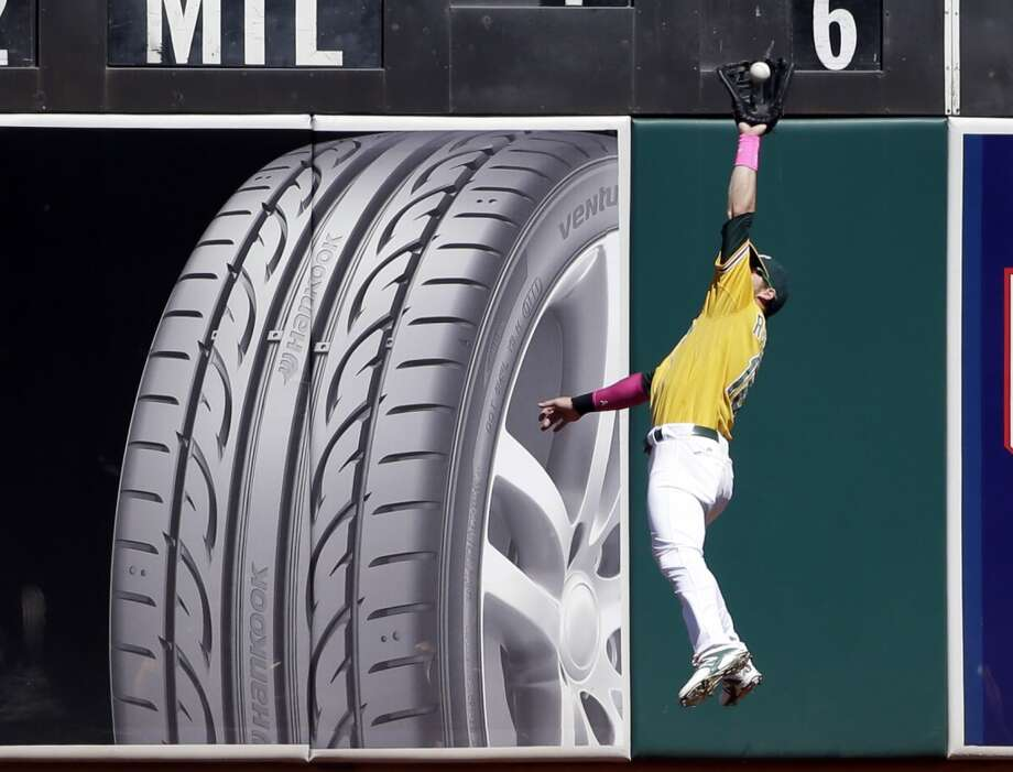 Must-see (defense):  Josh Reddick pursuing a fly ball at the wall Photo: Marcio Jose Sanchez, Associated Press