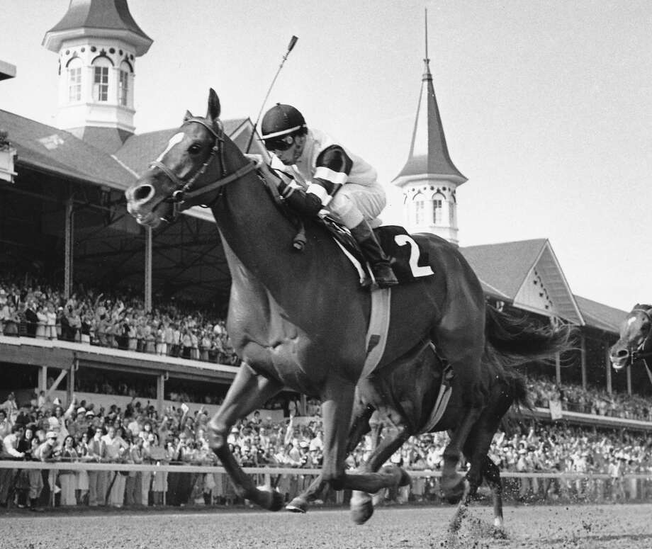 Affirmed, horse racing's last Triple Crown winner, finishes the 1978 Kentucky Derby with jockey Steve Cauthen aboard. Photo: Associated Press