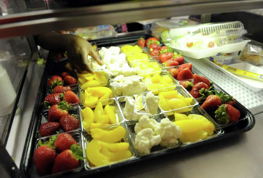 School cafeterias nationwide are saying they are unable to meet the federal government's healthy lunch nutrition requirements due to a decrease in revenue. Photo: Susan Walsh, STF / AP