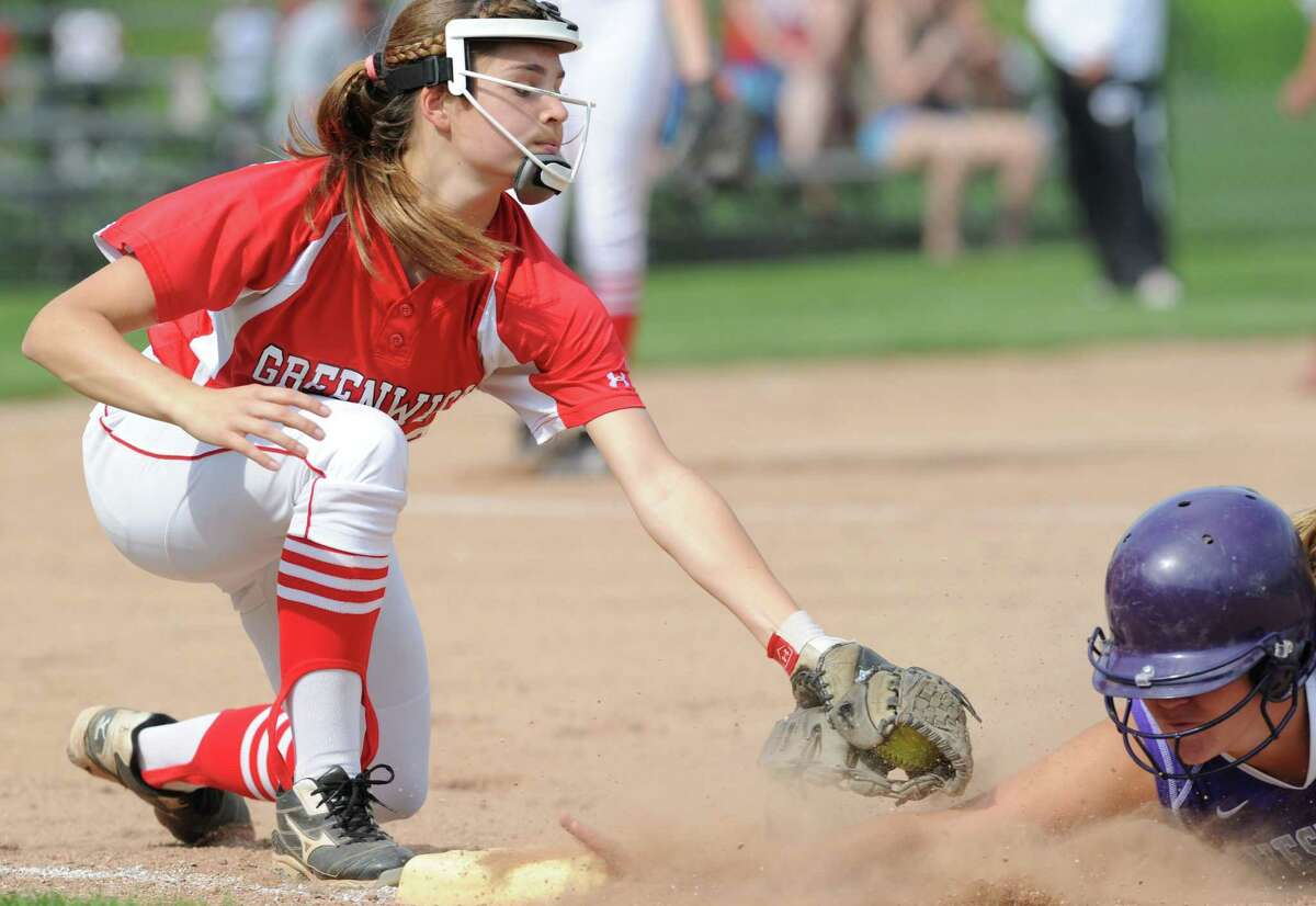 Greenwich first basewoman Dakota Sarcone, left, tags Westhill's Alyssa Blank during a pick-off attempt during the FCIAC girls high school softball quarterfinal game between Greenwich High School and Westhill High School at Greenwich, Tuesday, May 27, 2014. Blank was safe on the play. Westhill defeated Greenwich, 5-1.