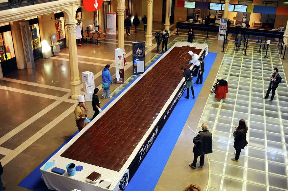 The biggest chocolate tablet in the world, made by Italian confectioners Giuseppe Sartoni and Mirco Della Vecchia, was awarded by the Guinness World Records, during the Cioccoshow 2011 opening day at Sala Borsa on Nov. 16, 2011 in Bologna, Italy. Photo: Mario Carlini - Iguana Press, Getty Images / 2011 Mario Carlini - Iguana Press