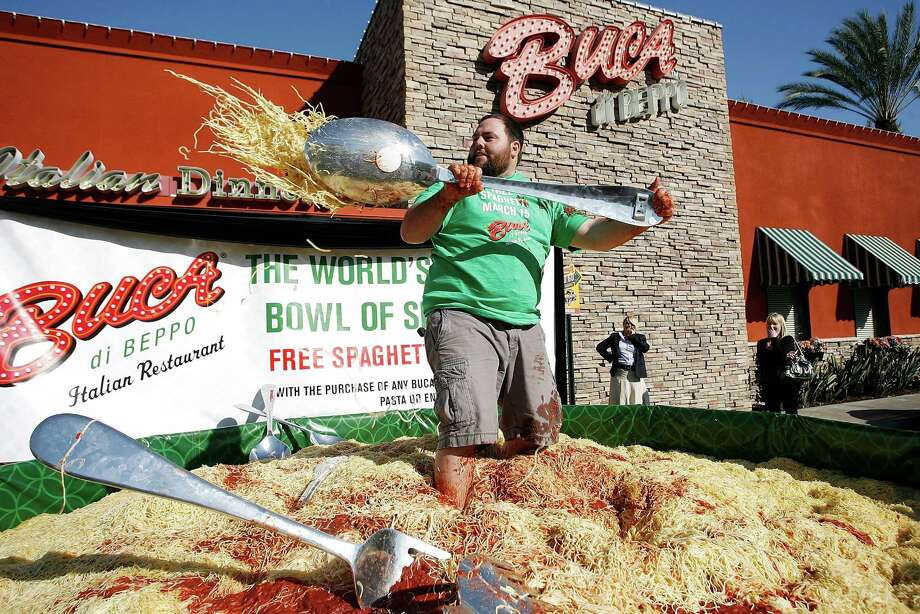YouTube personality Shay Carl plays in a 15 foot, 13,786-pound, bowl of spaghetti at the Italian eatery Buca di Beppo on March 12, 2010, in Anaheim, California. Six chefs supervised the preparation and production of the world record largest spaghetti that included more than 100 gallons of marinara sauce and hundreds of meatballs. Photo: Robert Benson, WireImage Via Getty Images / 2010 WireImage