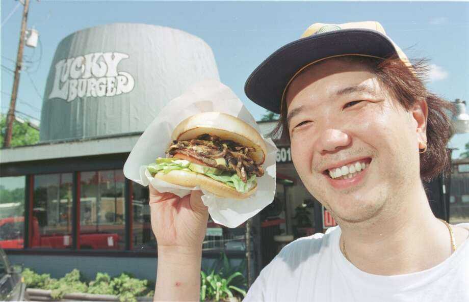 Thomas Tse at Lucky Burger. hamburger in June 1998.  Tse holds with a Mushroom Cheeseburger from the burger joint. Photo: D. Fahleson, Houston Chronicle