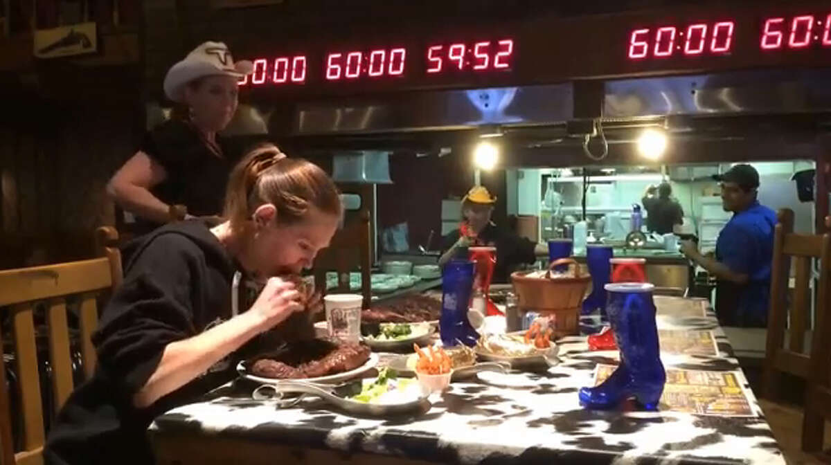 Molly Schuyler on Monday, May 26, 2014, devours a 72-ounce steak at the Big Texan Steak Ranch in Amarillo in a still taken from a YouTube video by Molly Schuyler.