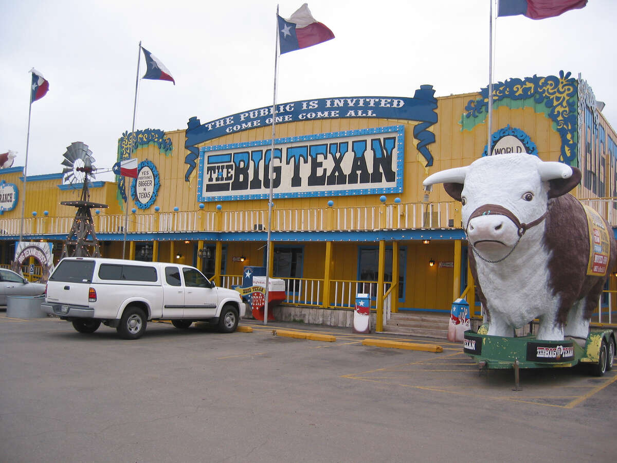 2. Amarillo  If you're driving along Route 66, be sure to make a pit-stop in Amarillo, where you'll find The Big Texan Steak House, home of the 72-ounce steak. And if you're in the mood for something quirky, check out the roadside art attraction Cadillac Ranch, featuring 10 graffiti-covered Cadillacs.