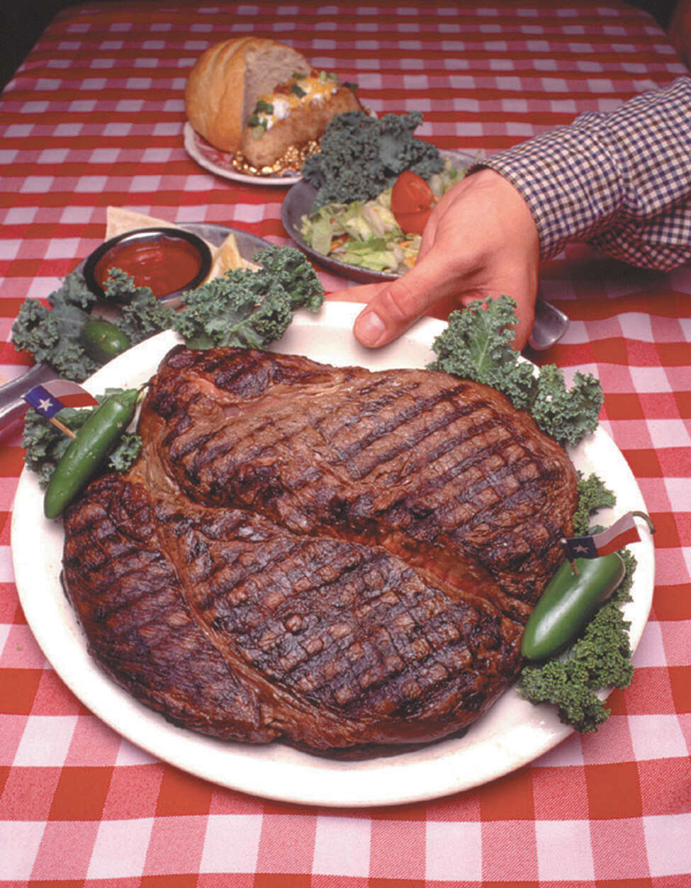 If you can eat the 72-ounce steak at the Big Texan restaurant in Amarillo in one hour, it's free. Not many succeed, but a competitive eater from Nebraska has set a record by devouring two of the huge steaks. Still hungry? While they aren't all record-breaking, click ahead to see more dishes in the Alamo City, Texas and around the globe that will fill you up ... and then some.