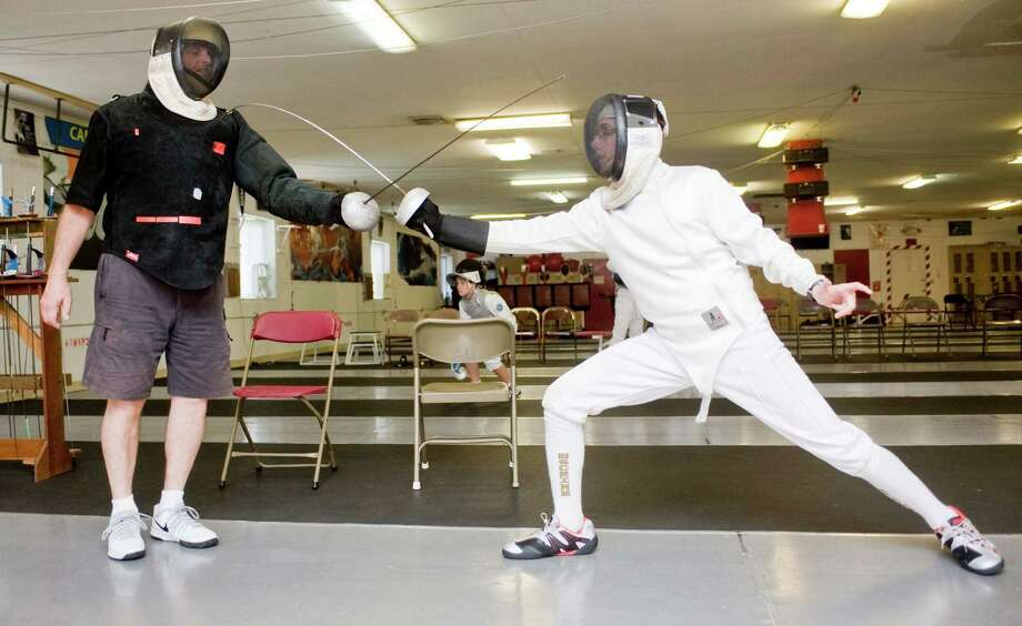 Candlewood Fencing Center owner Tom Ciccarone, left, gives a private lesson to Stephen Bruno of Newtown, at the Candlewood Fencing Center in Danbury. Tuesday, May 27, 2014 Photo: Scott Mullin / The News-Times Freelance