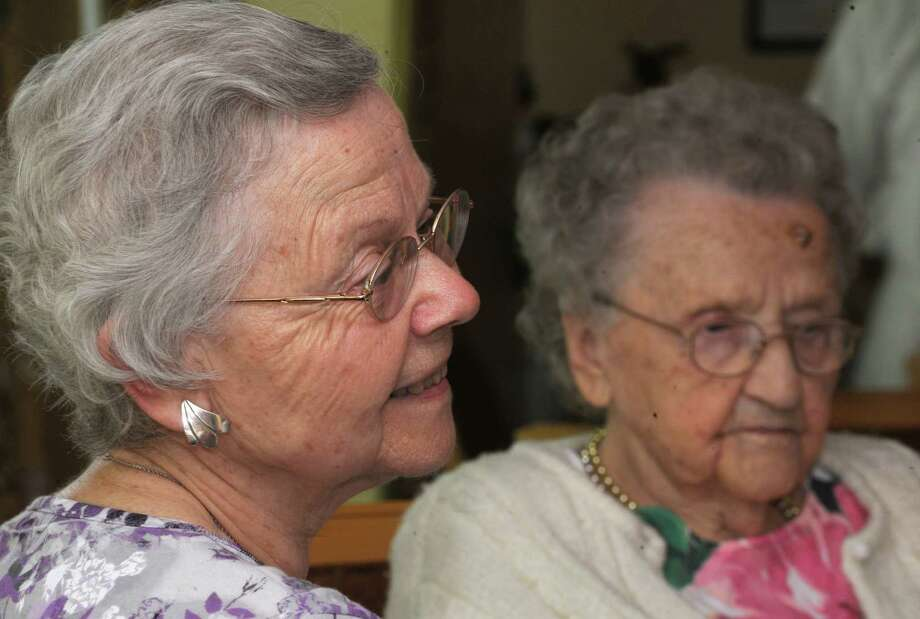 Miloslava (Milena) Leukhardt of Latham, left, talks about her mother Anastazie (Anne) Kovar's, right, life as Anne celebrates her 104th birthday today at Loudonville Assisted Living Residence on Tuesday, May 27, 2014 in Colonie, N.Y.  She was born in 1910 in what is now the Czech Republic. (Lori Van Buren / Times Union) Photo: Lori Van Buren / 00027054A