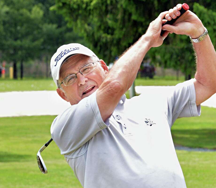 Chuck Connolly of Queensbury practices his wedge shot at Northway Golf Tuesday May 27, 2014, in Clifton Park, NY.  (John Carl D'Annibale / Times Union) Photo: John Carl D'Annibale / 00027049A