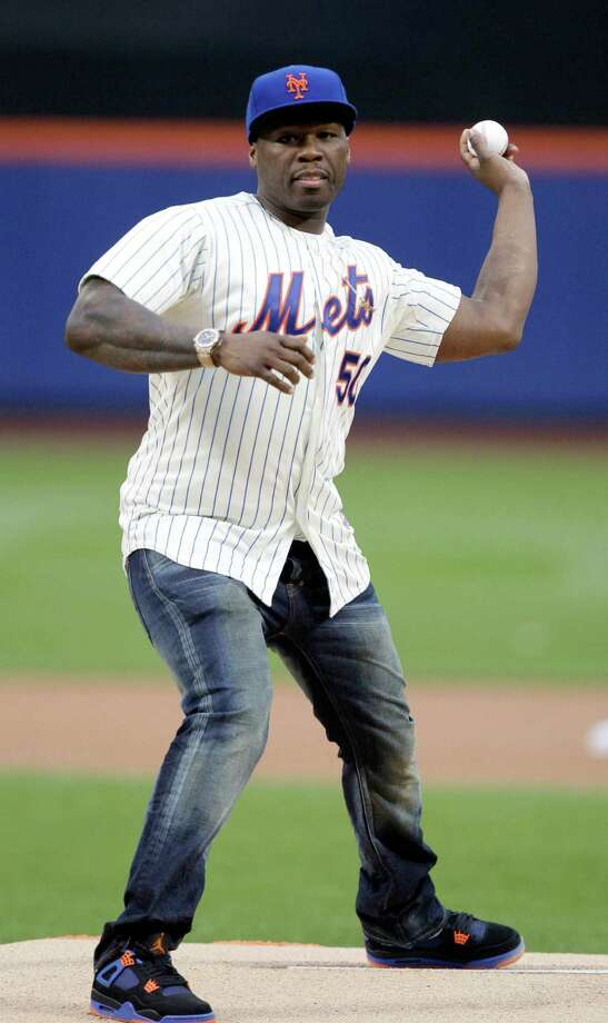 50 Cent throws out the ceremonial first pitch before a baseball game between the New York Mets and the Pittsburgh Pirates on Tuesday, May 27, 2014, in New York. (AP Photo/Frank Franklin II) Photo: Associated Press / AP