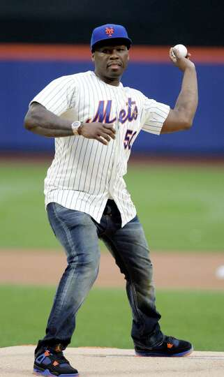 50 Cent throws out the ceremonial first pitch before a baseball game between the New York Mets and t