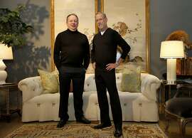 Phillip Silver (left) and Graham Bigelow stand in front of a Chinoiserie Monkey panels by LX Rossi and a Syrie Maugham sofa at Michael Taylor Designs Thursday April 24, 2014. Interior designers Graham Bigelow and Phillip Silver are photographed at Michael Taylor in the design district of San Francisco, Calif.