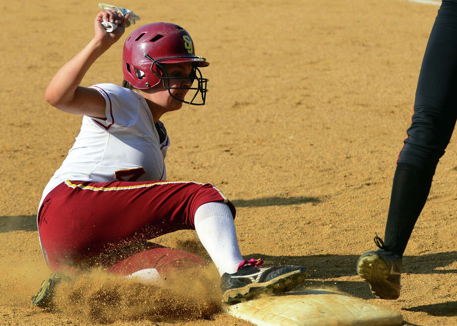 St. Joseph's Amy Chacho slides into third, during softball action against New Canaan in Trumbull, Conn. on Tuesday May 27, 2014. Photo: Christian Abraham / Connecticut Post