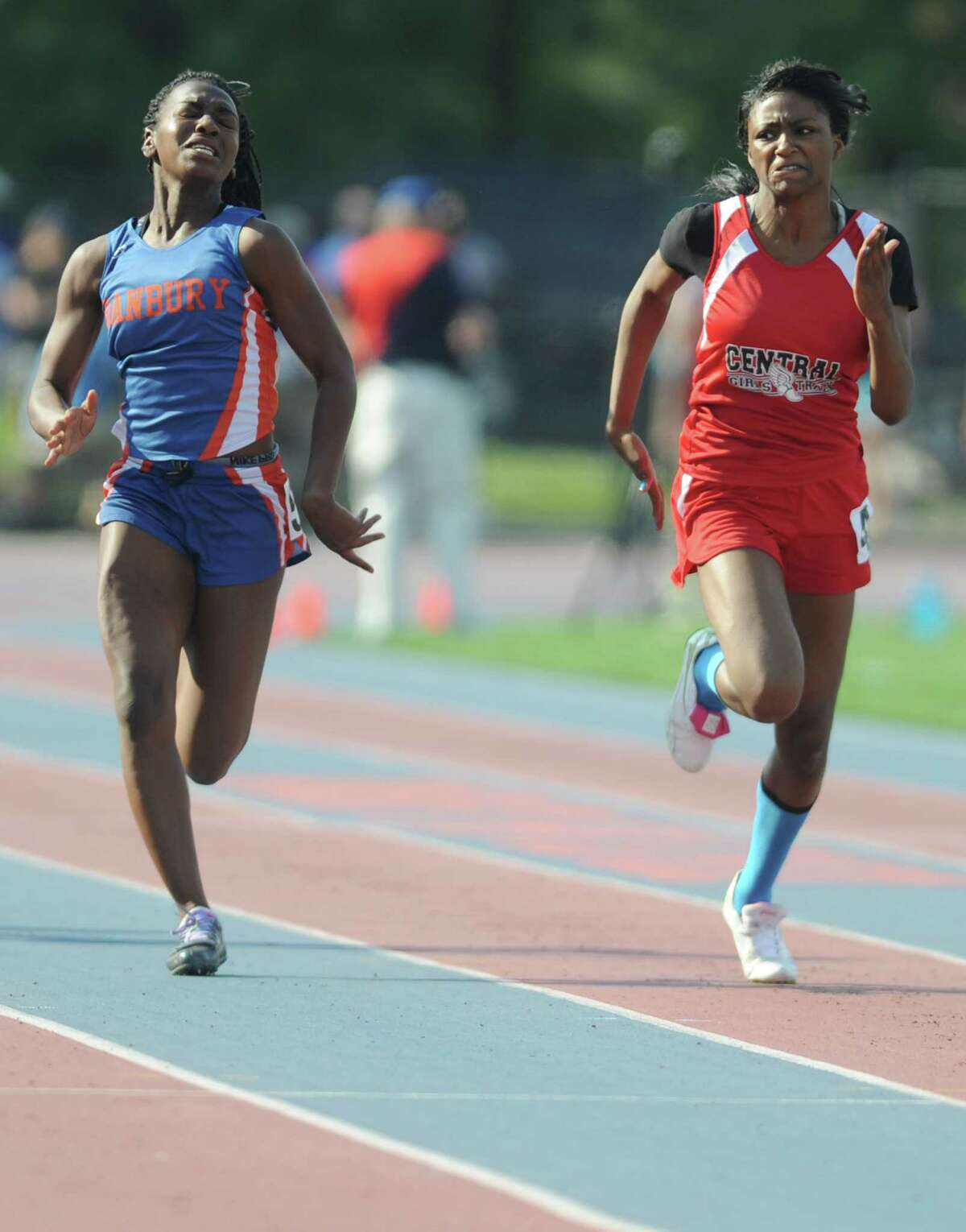 Danbury's Niema Riley, left, and Bridgeport Central's Kanajzae Brown battle in the girls 100 meter dash at the high school FCIAC track and field championships at Danbury High School in Danbury, Conn. Tuesday, May 27, 2014. Brown won the event with a time of 12.37 seconds and Riley finished second.