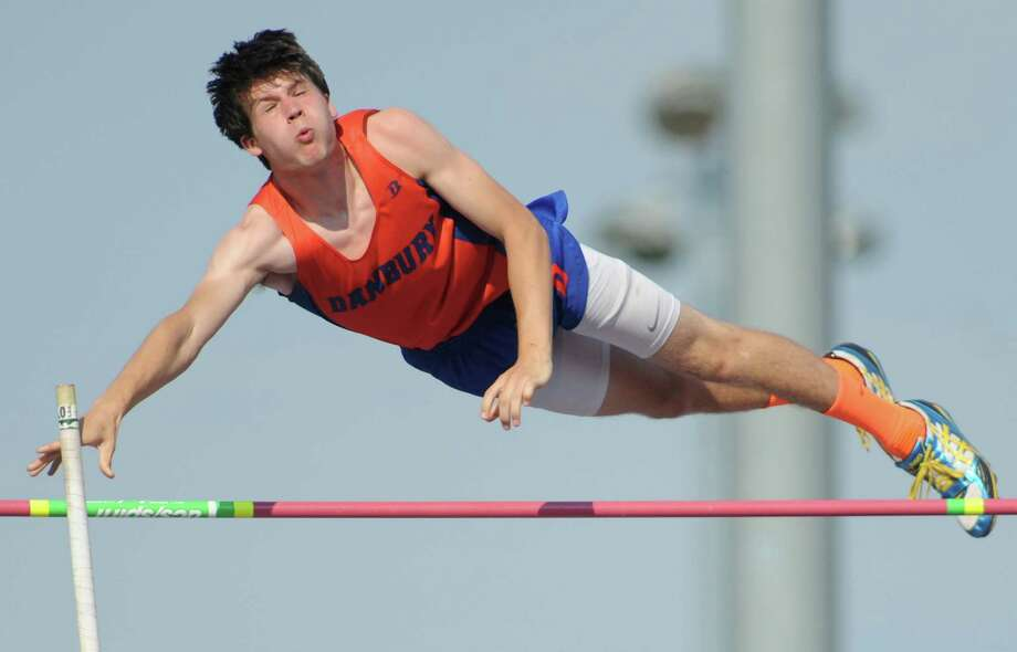 Danbury's Leland Roberts competes in the boys pole vault in the high school FCIAC track and field championships at Danbury High School in Danbury, Conn. Tuesday, May 27, 2014.  Roberts placed second in the event. Photo: Tyler Sizemore / The News-Times
