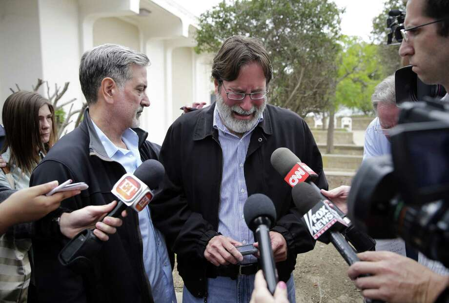Richard Martinez (center), whose son was killed in the mass shooting in California, is comforted by his brother, Alan, as he talks to media. Photo: Jae C. Hong / Associated Press / AP