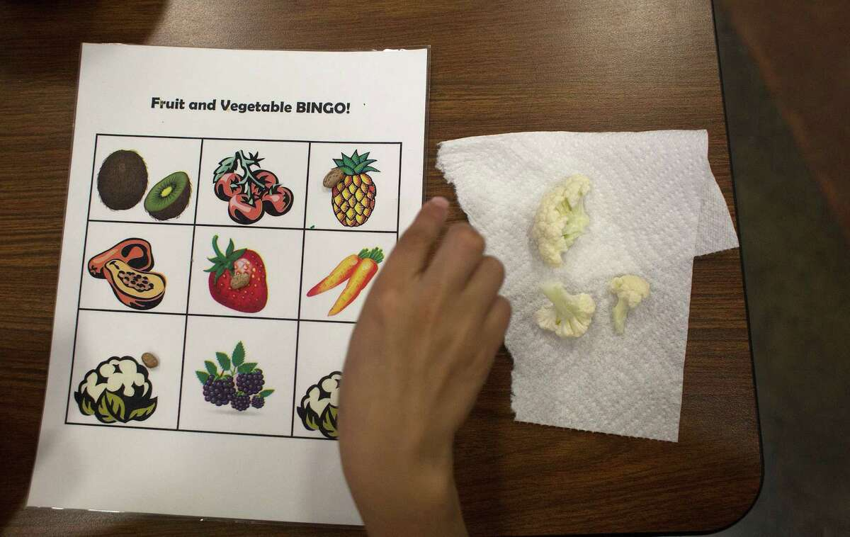 Students at Veggie Fest played Fruit and Vegetable Bingo while sampling a variety of food they may never have encountered - such as cauliflower, above.