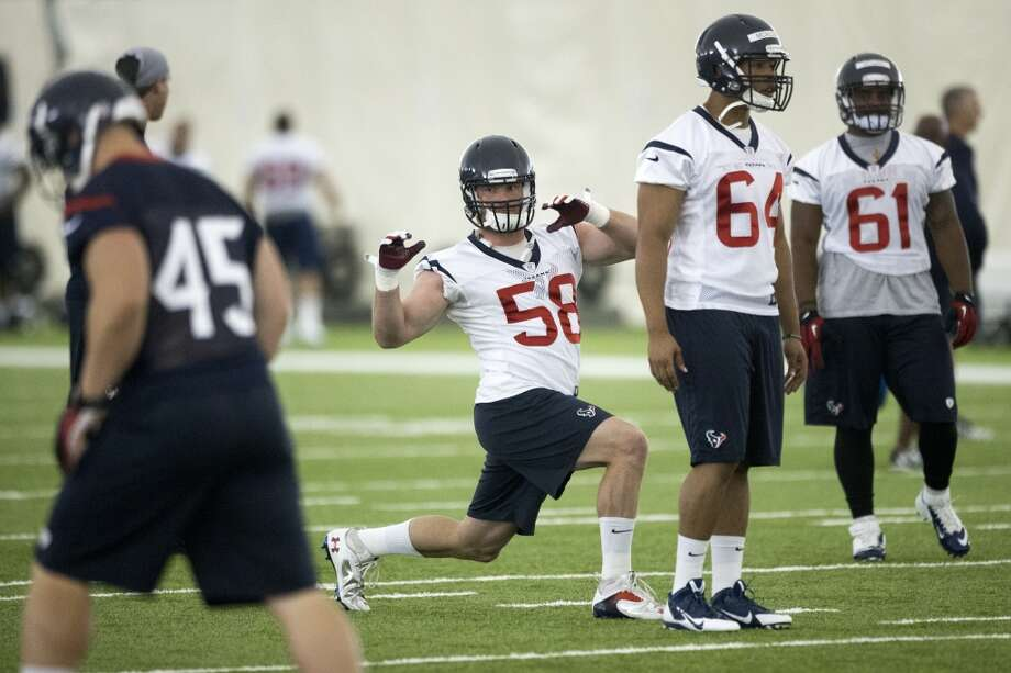 Texans linebacker Brooks Reed (58) stretches with his teammates Jay Prosch (45), Chris McAllister (64) and Chris Young (61). Photo: Brett Coomer, Houston Chronicle