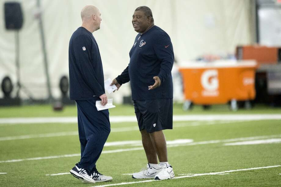 Texans quarterbacks coach George Godsey, left, talks to defensive coordinator Romeo Crennel. Photo: Brett Coomer, Houston Chronicle