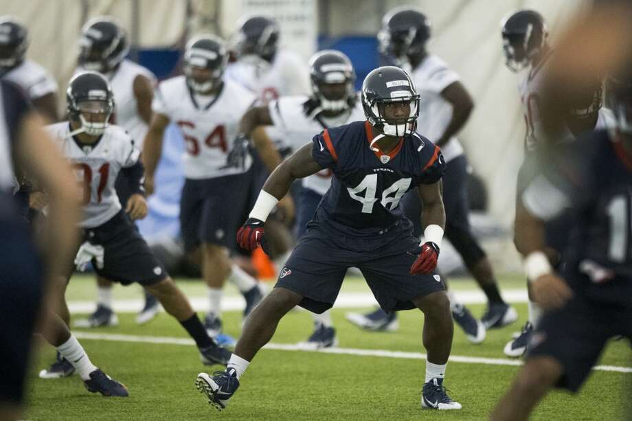 Texans running back Alfred Blue (44) warms up. Photo: Brett Coomer, Houston Chronicle
