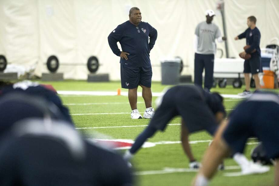 Texans defensive coordinator Romeo Crennel watches his players stretch. Photo: Brett Coomer, Houston Chronicle