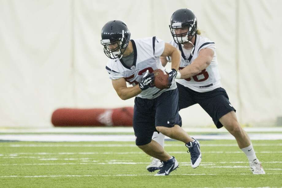 Texans linebackers Jeff Tarpinian (52) and Brooks Reed (58) run a drill. Photo: Brett Coomer, Houston Chronicle