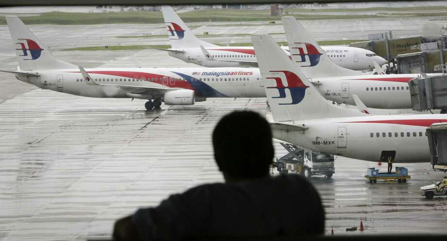 The Malaysian government on Tuesday released 45 pages of raw satellite data it used to determine the flight path of its missing jetliner. Photo: Vincent Thian / Associated Press / AP