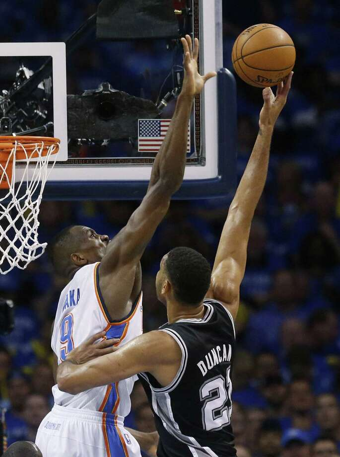 Oklahoma City Thunder forward Serge Ibaka elevates to block a shot by San Antonio Spurs forward Tim Duncan in of Game 3 of the Western Conference finals in Oklahoma City. OK — no pun intended — a reader knows the Spurs did not shoot as well as they should have, but he contends that the refs had something to do with their defeat. Photo: Sue Ogrocki / Associated Press / AP