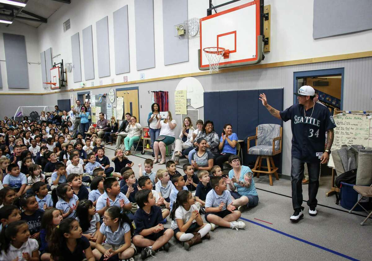 Felix Hernandez enters the gymnasium as Seattle Mariners players visit Hilltop Elementary School in Burien on Tuesday, May 27, 2014. Mariners players Robinson Cano, Felix Hernandez, Brad Miller, Taijuan Walker, Stefen Romero, and Mike Zunino visited the school as part of the D.R.E.A.M. program. The program stresses the principles of being drug-free, respect, education through reading, attitude and motivation to achieve dreams.